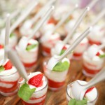 Pink coloured strawberry dessert in shot glass, catering buffet
